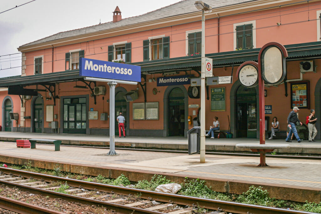 Train station at Monterosso Al Mare - pink building and train tracks