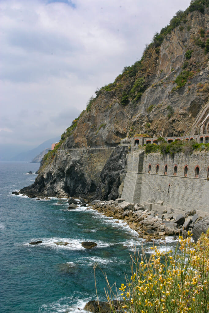 Rugged grey Cliffs at the start of the coastal hiking trail at Riomaggiore