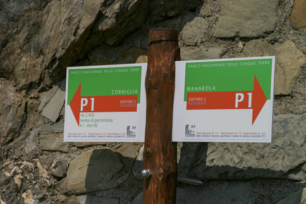 Corniglia and Manarola direction signs on the coastal trail Cinque Terre