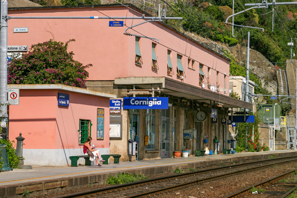 Pink building in front of Train tracks - Corniglia train station in the Cinque Terre.