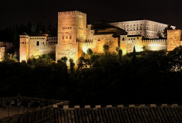Alhambra palace lit up in the dark night