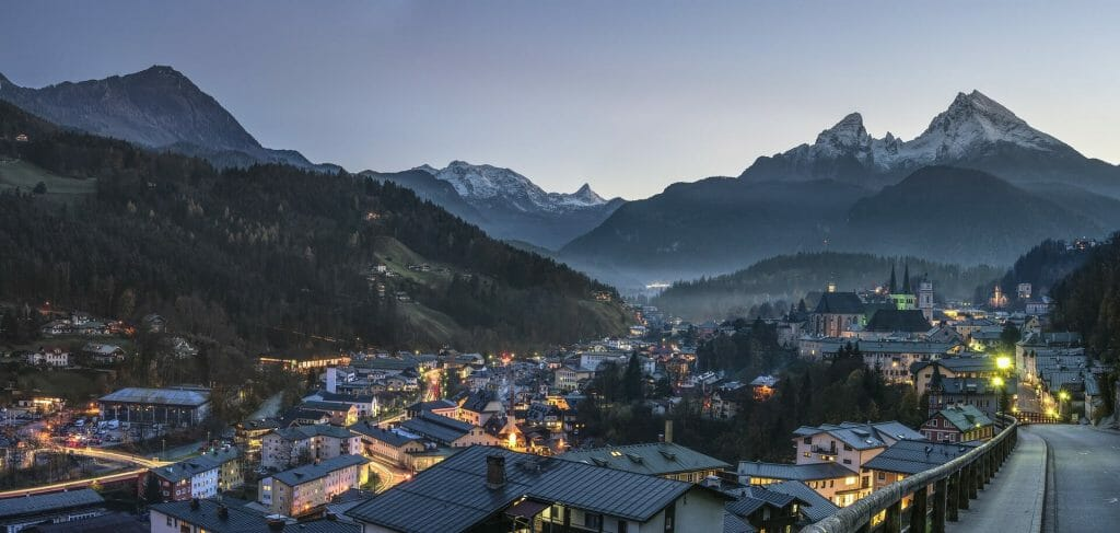 A mountain town in the evening with the night lights twinkling