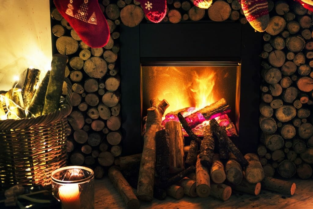 Blazing fireplace with stockings hanging over it