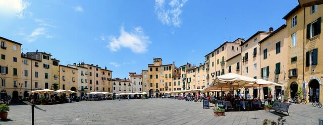 Bright Lucca plaza with the gentle hum of business starting to pick up at the market
