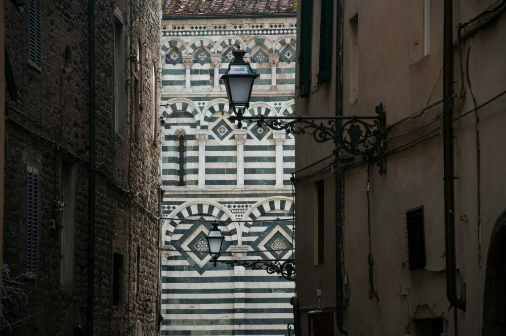 Artful lamp post in an alley in Pistoia