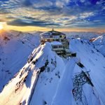 A resort on top of a snowy mountain