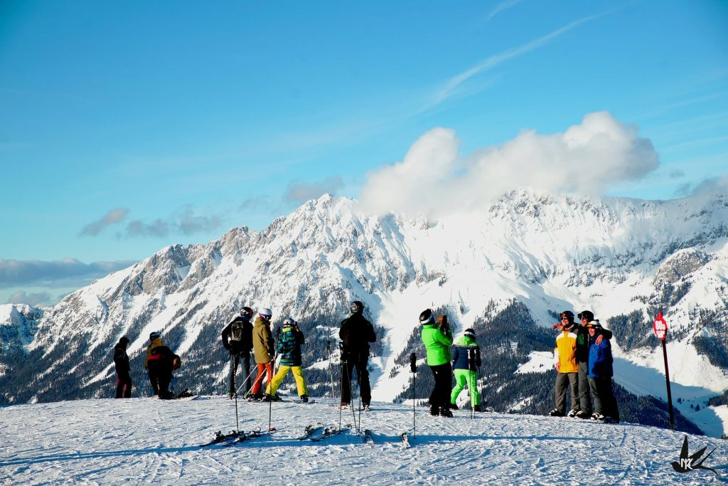 Skiers reveling at the picturesque mountains