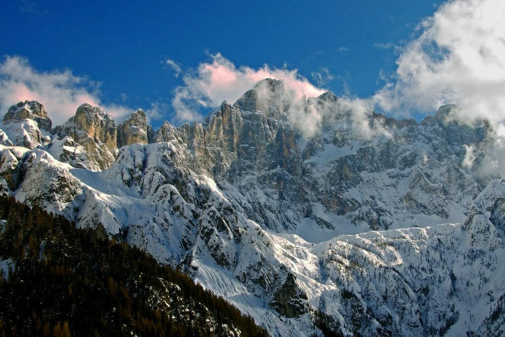 Imposing Dolomite peaks covered in snow