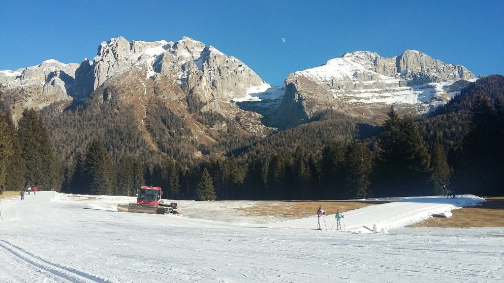Truck going around the snowy land in the Dolomites
