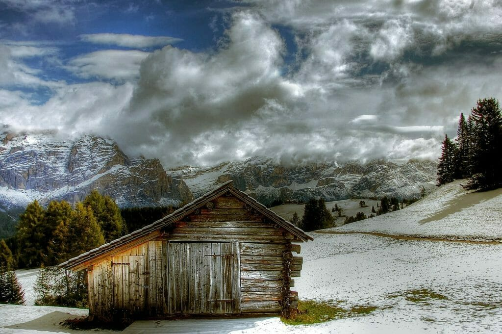 Cabin in Alta Badia, Italy at the very beginning of winter with little snow on the ground