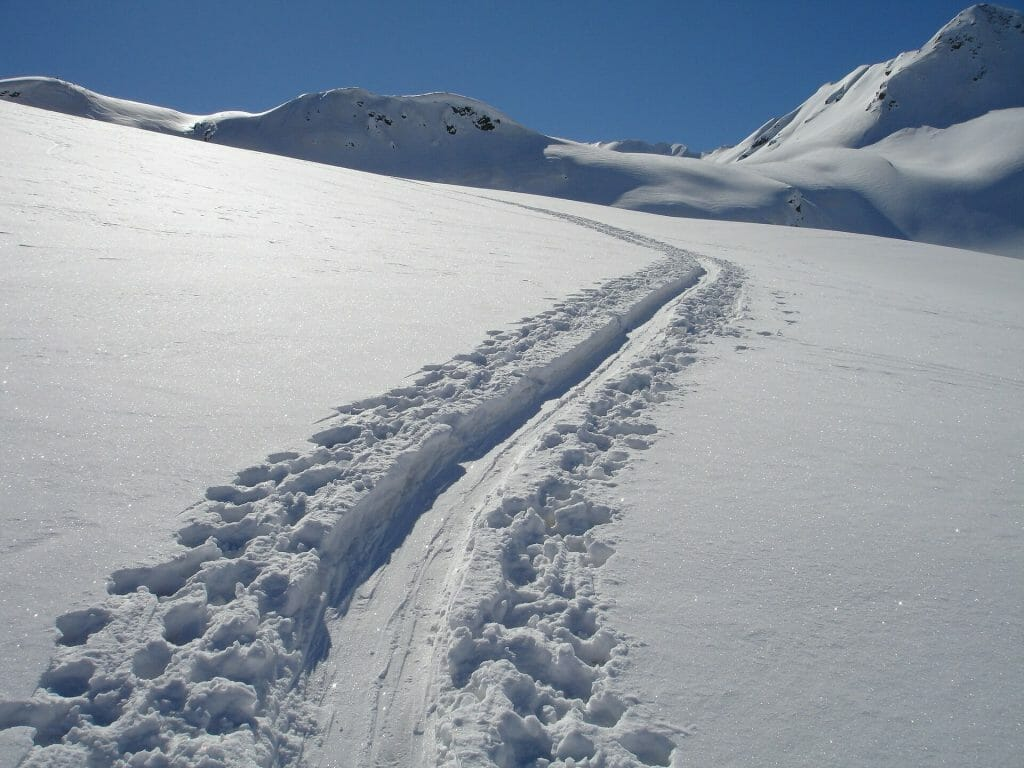 Tracks in the snow of a trail in Italy