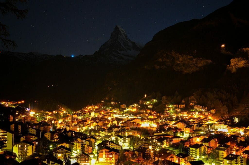 Twinkling Italian city on the Swiss thrumming with life