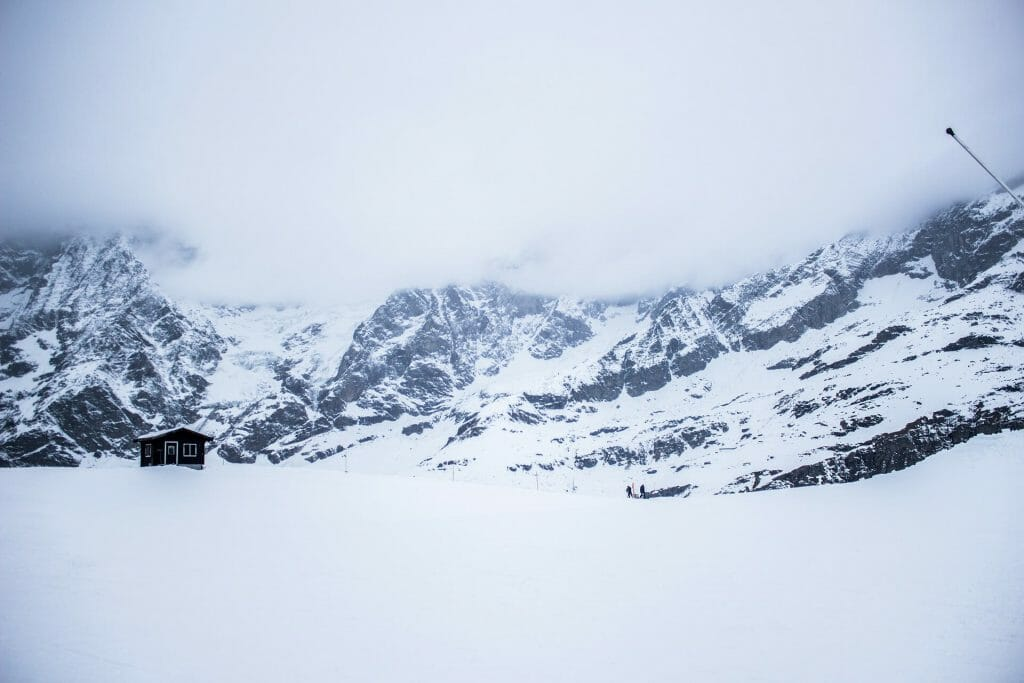 A single cabin in the middle of a mystical and barren mountain pass
