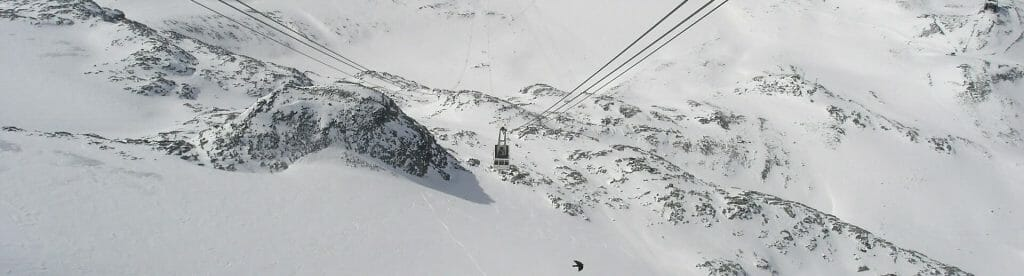 Chair lift going down the Cervinia slopes on a picturesque winter day