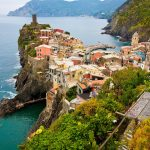 Colorful houses cluttered peacefully on the cliffs of the Italian coast