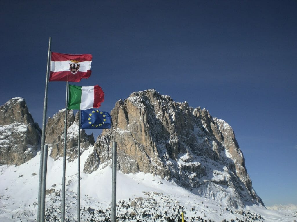 Flags of the Dolomites waving gracefully in the Dolomite peaks