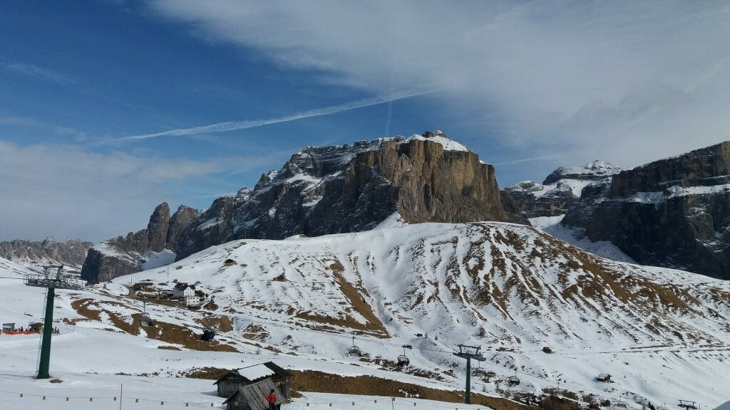 Ski lifts going over the beautiful wild slopes of Sella Ronda, Italy
