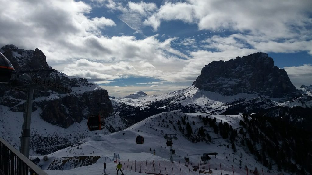 Sella Ronda slopes and ski lifts alive with visitors on a beautiful winter day