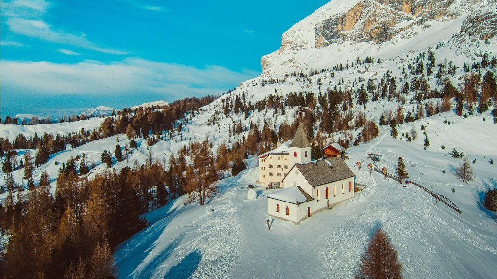 Church in the middle of the Alta Badia mountain area with the sun shining