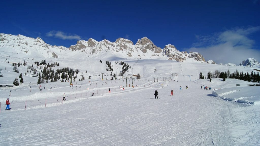 Bustling Italian slopes in the middle of a winter day