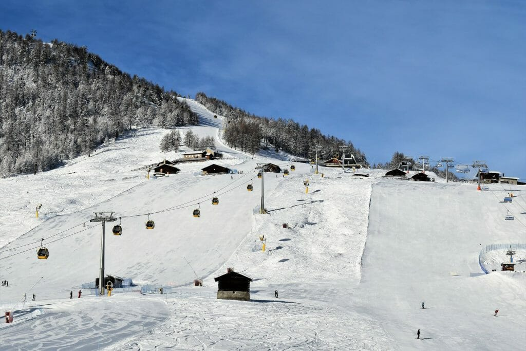 Well groomed ski slopes at the beginning of a lovely winter day in Italy
