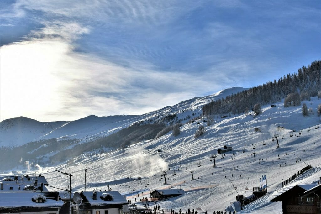 The bustling ski slopes of Livigno, Italy as the sun humbly caresses the slopes