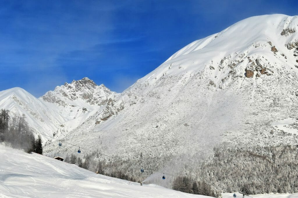 Freshly fallen snow on a crisp Italian mountain plain