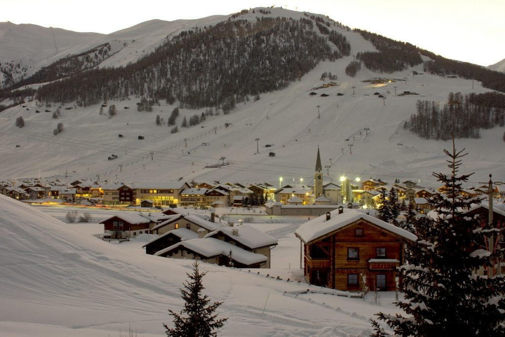 Humble town of Livigno glowing with evening light in the gorgeous winter time