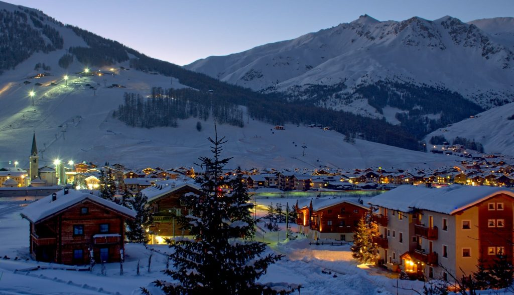 Twinklihng evening lights all around Livigno with the town humming with life