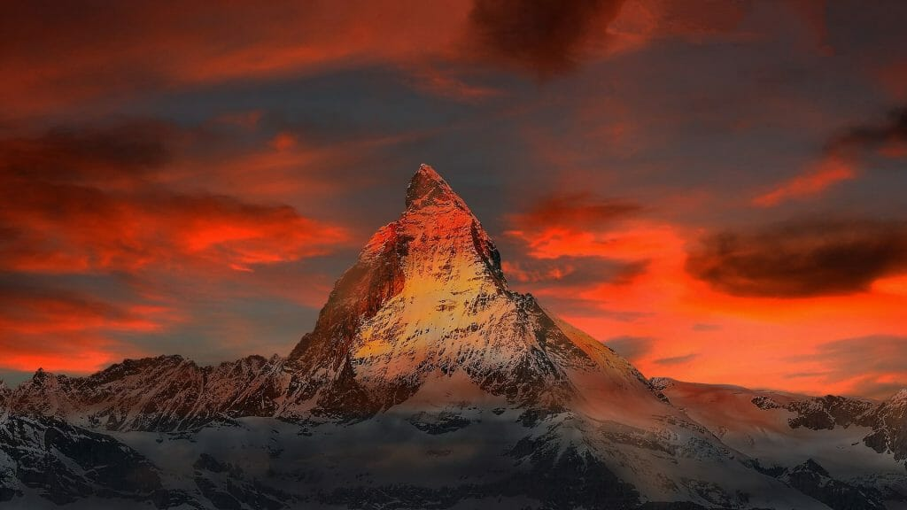 Mount Matterhorn tinted orange and red with the sunset