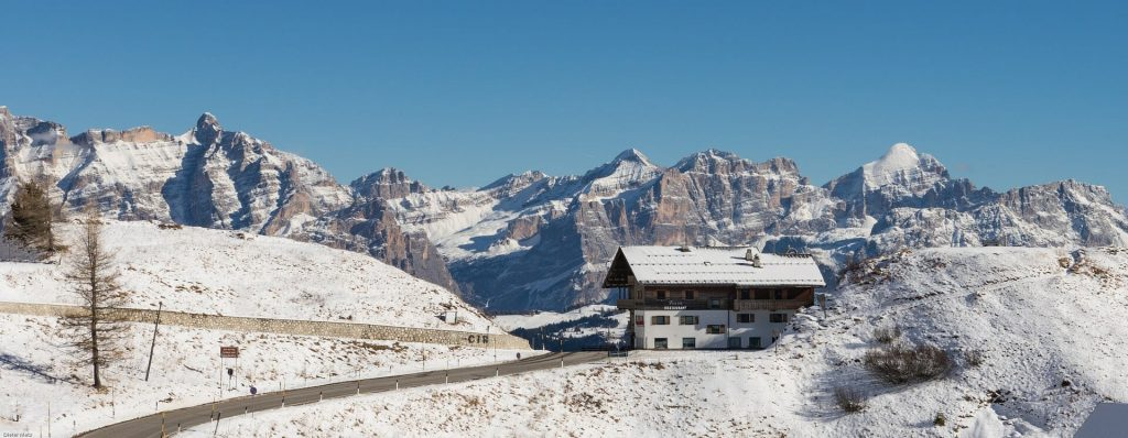 Ski resort in Val Gardena, Italy with snow surrounding it gracefully