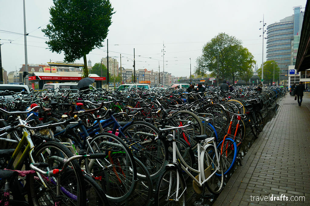 A mountain of bikes on each other on an Amsterdam street side