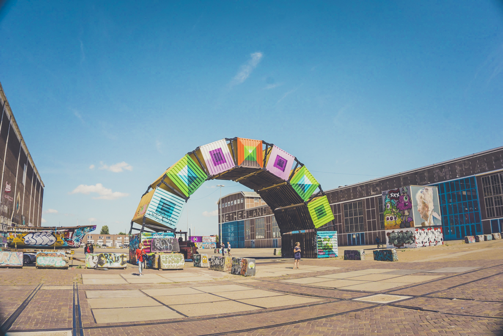 Colorful arch in the NDSM neighborhood on a sunny day with a sparse amount of people dotting the view