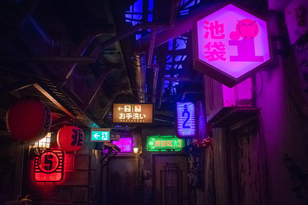 Neon signs in Japanese dotting and clustered in a dark street