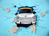 "Graffiti of trabi car driving ""through the Berlin Wall"" with license plate Nov 9, 1989"