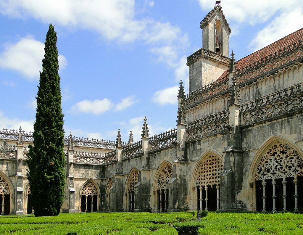 The Monastery of Jeronimos with its towering gothic architecture on a sunny day in Lisbon