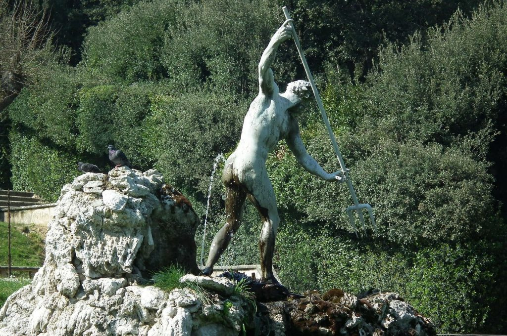 Statue of Neptune gallantly aiming his spear at the waters as a fountain trickles on his backside