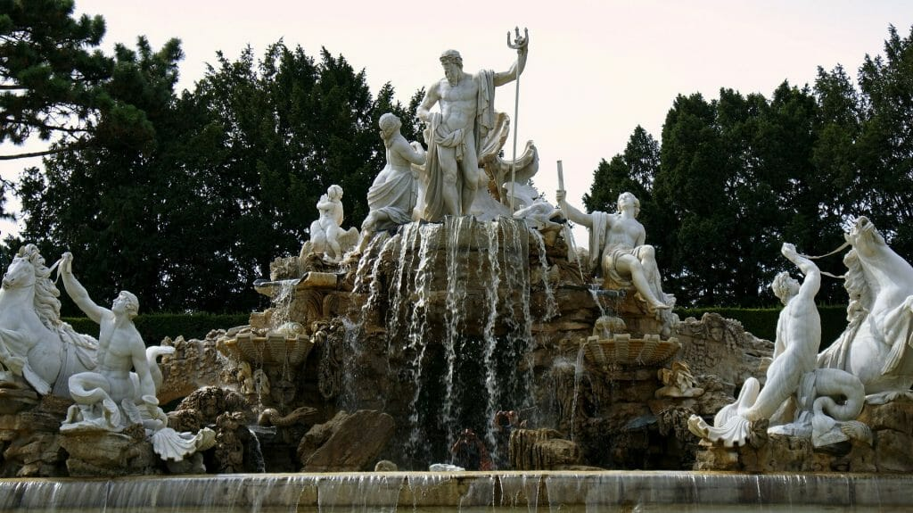 Marble statues of the Gods and Goddesses as the fountain runs