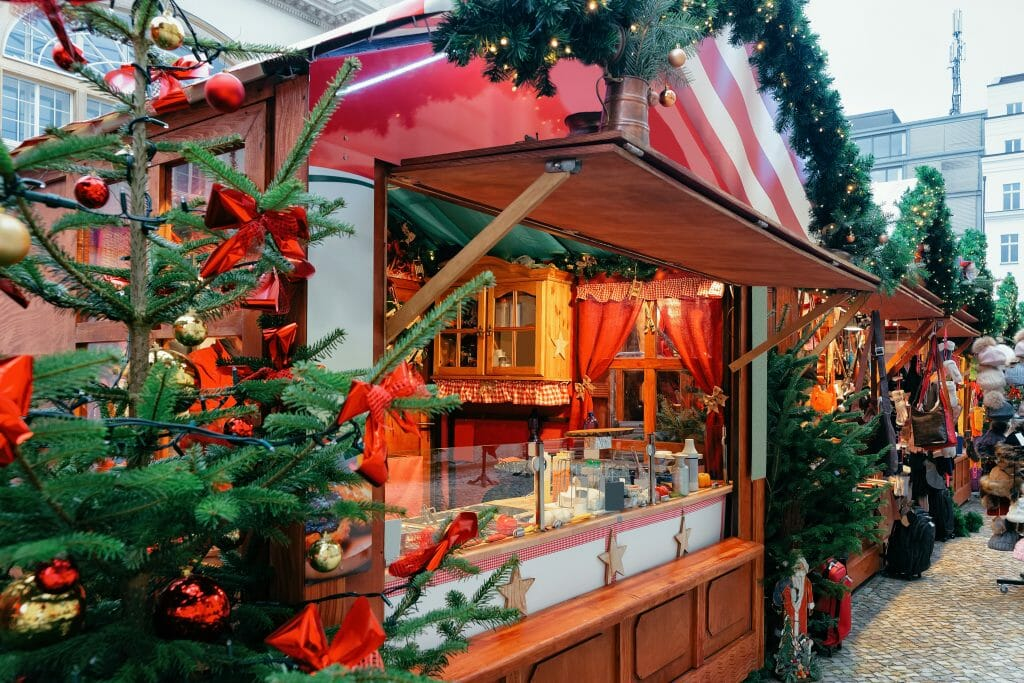 Christmas Market at Opernpalais at Mitte of Winter Berlin, Germany. Advent Fair Decoration and Stalls with Crafts Items on the Bazaar.