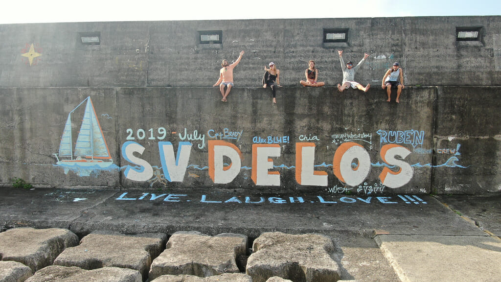 SV Delos Crew and Mural in Faial Island, Azores