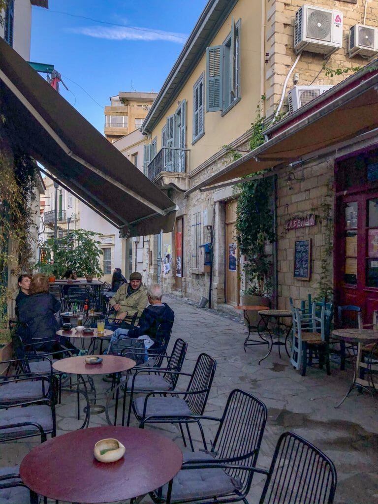 Cute narrow street in Limassol with cafes