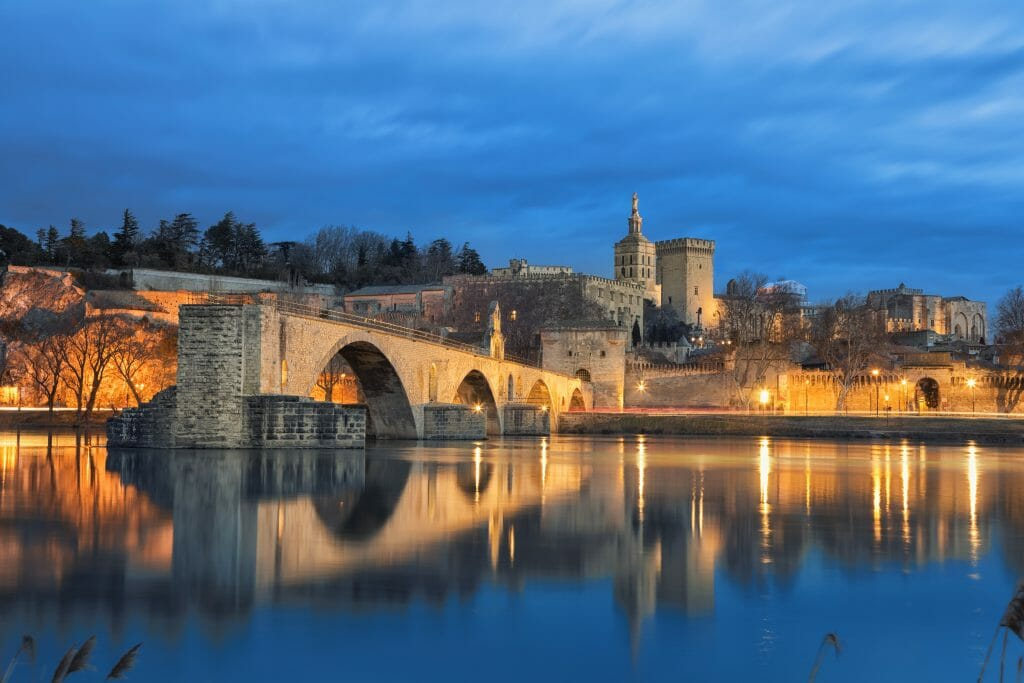 bridge and palais in avignon during blue hour with dark blue sky