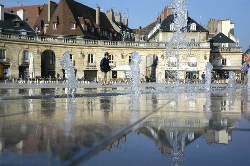 Place de la Libération fountain with reflection in the water