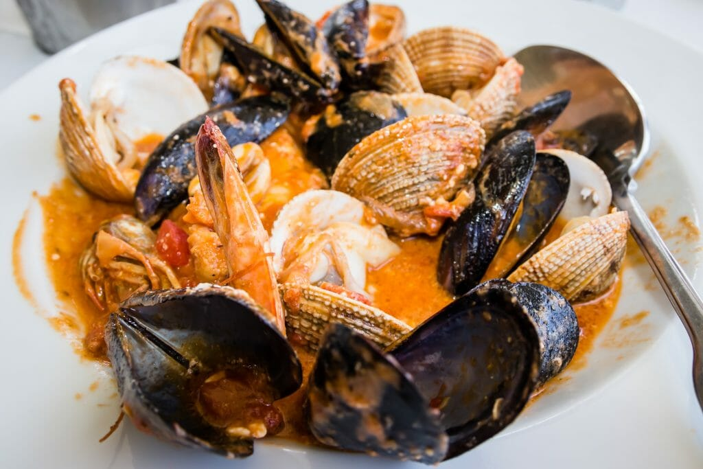 Greek saganaki of mussels in shell with shrimps