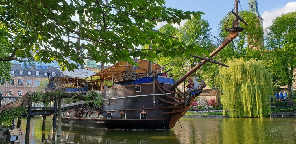Wooden ship on canal in front of Tivoli Gardens in Copenhagen