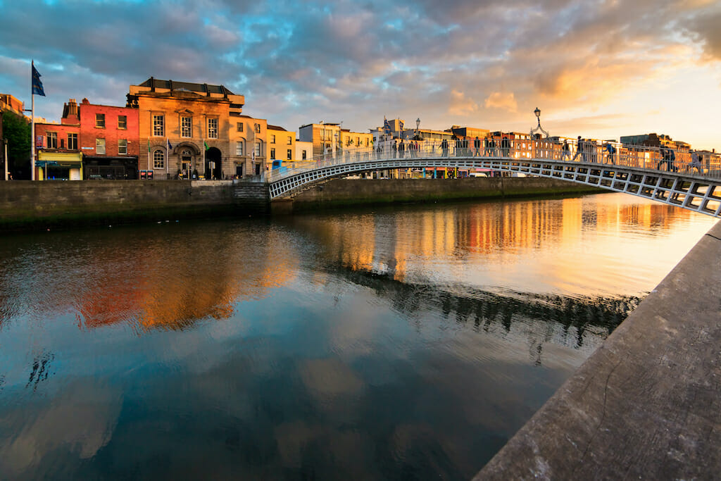 Sunset over the dublin bridge and the city