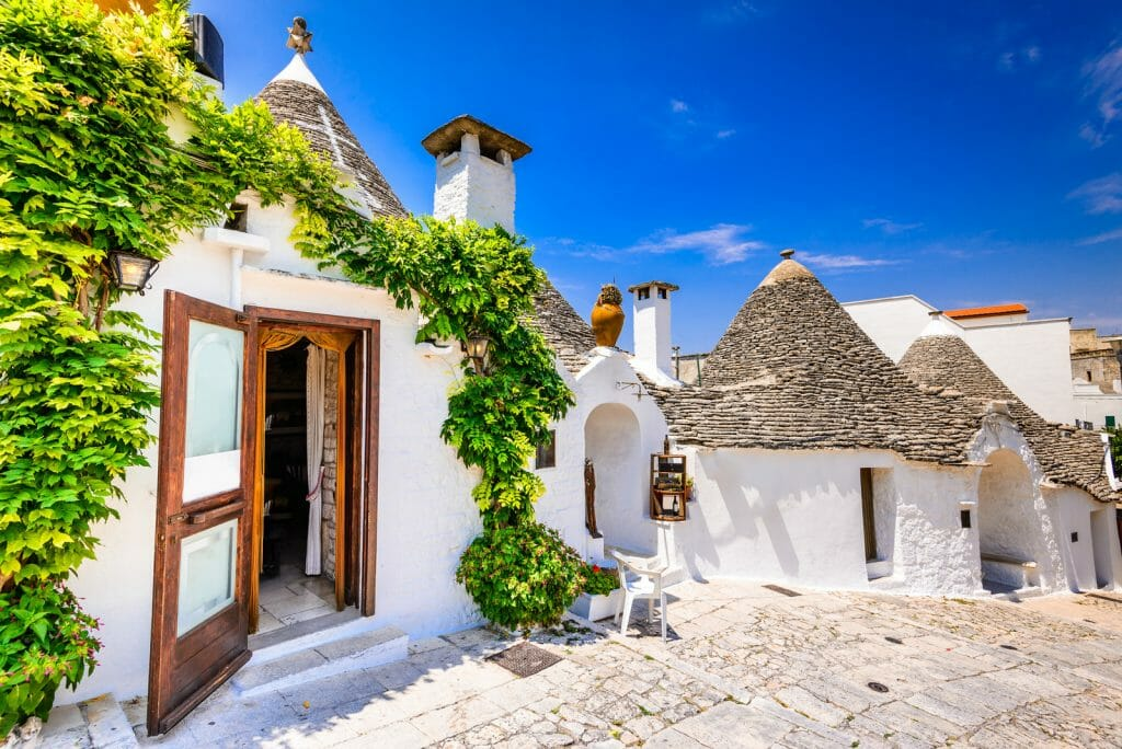 ALBEROBELLO, ITALY - UNESCO heritage city in Italy, Puglia. Trulli or Trullo houses with conical roofs, traditional Apulian dry stone hut.