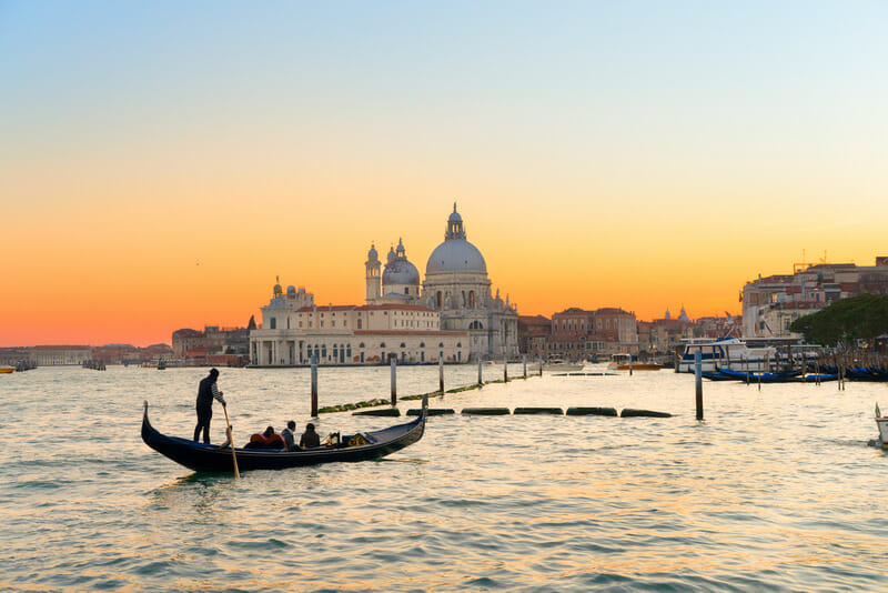 Basilica Santa Maria della Salute and lagoon water at sunset, Venice, Italy