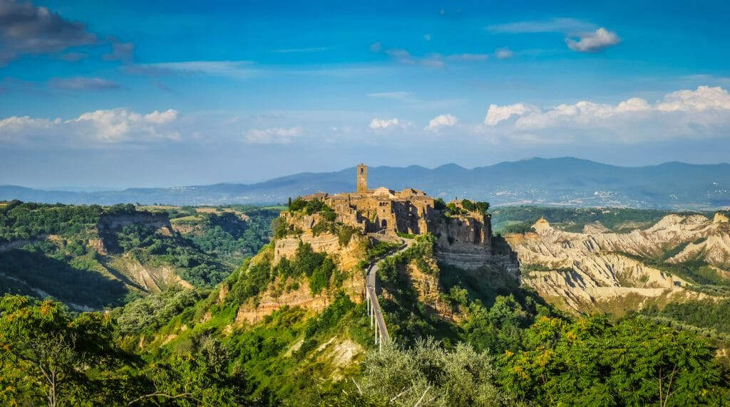 Beautiful panoramic view of famous Civita di Bagnoregio with Tiber river valley in golden evening light, Lazio, Italy
