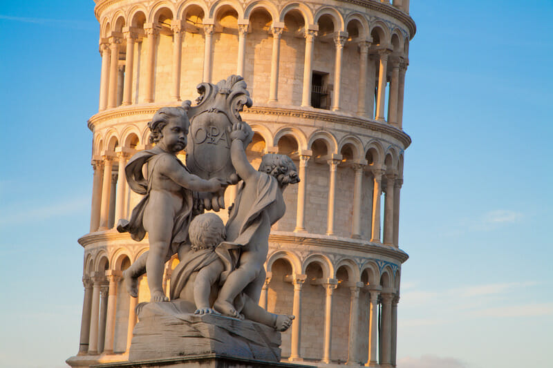 Pisa - The angles sculpture and Hanging tower in evening light